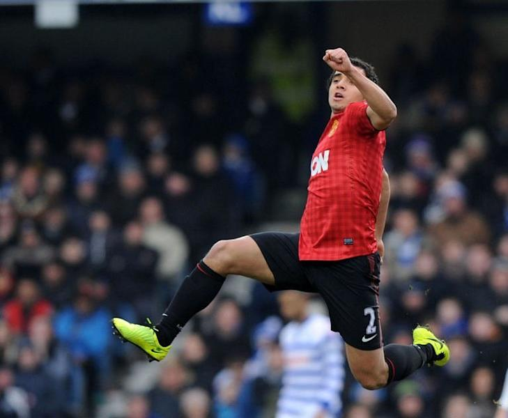 Manchester United's defender Rafael da Silva celebrates scoring during an English Premier League football match against Queens Park Rangers at Loftus Road in London on February 23, 2012. Manchester United won 2-0