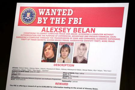 A poster of suspected Russian hackers is seen before FBI National Security Division and the U.S. Attorney's Office for the Northern District of California joint news conference at the Justice Department in Washington