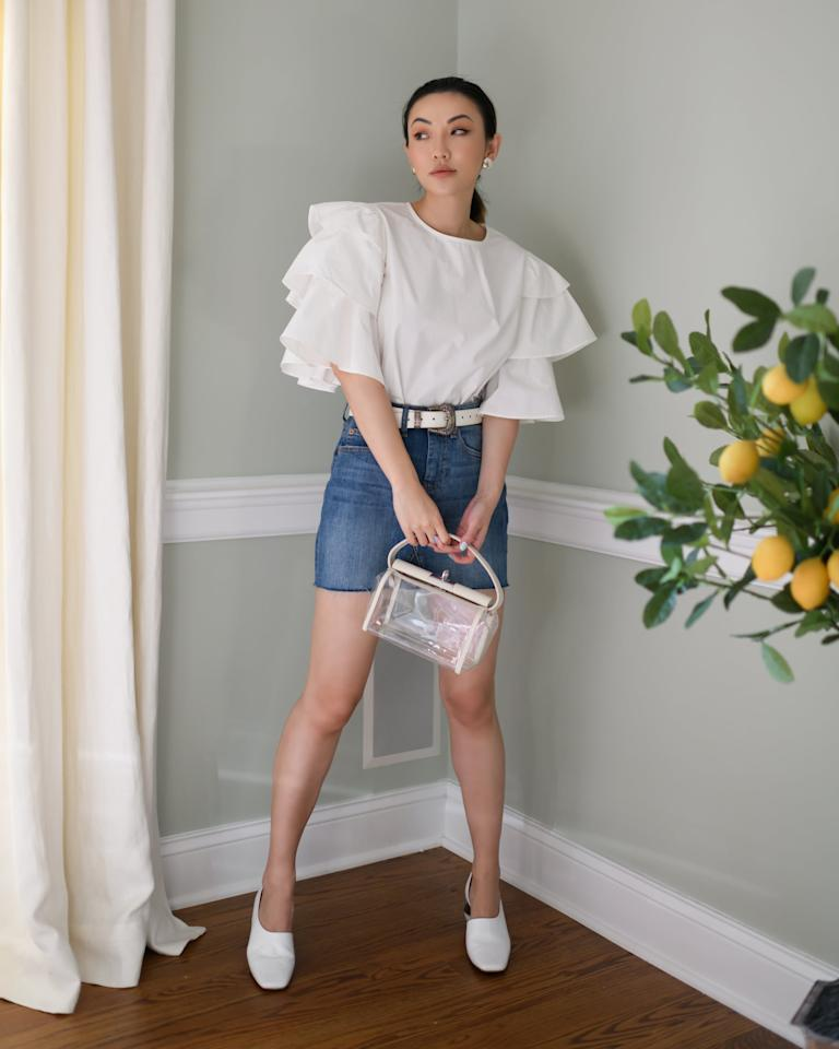 "<p><a href=""https://www.popsugar.com/buy/Drop-Cloud-Crewneck-Tiered-Ruffle-Sleeve-Top-584017?p_name=The%20Drop%20Cloud%20Crewneck%20Tiered%20Ruffle%20Sleeve%20Top&retailer=amazon.com&pid=584017&price=55&evar1=fab%3Auk&evar9=47548803&evar98=https%3A%2F%2Fwww.popsugar.com%2Ffashion%2Fphoto-gallery%2F47548803%2Fimage%2F47555467%2FComfy-Ruffled-Tee&list1=shopping%2Camazon%2Csummer%20fashion&prop13=api&pdata=1"" rel=""nofollow"" data-shoppable-link=""1"" target=""_blank"" class=""ga-track"" data-ga-category=""Related"" data-ga-label=""https://www.amazon.com/dp/B0896NQFX3/ref=thedrp_hm_stlk_dp?theDropLookIdDpx=54ddf902-5787-4333-a269-bb7ab7153473"" data-ga-action=""In-Line Links"">The Drop Cloud Crewneck Tiered Ruffle Sleeve Top </a> ($55)</p> <p><a href=""https://www.popsugar.com/buy/Drop-Rosemore-Deconstructed-Denim-Mini-Skirt-584018?p_name=%20The%20Drop%20Rosemore%20Deconstructed%20Denim%20Mini%20Skirt&retailer=amazon.com&pid=584018&price=40&evar1=fab%3Auk&evar9=47548803&evar98=https%3A%2F%2Fwww.popsugar.com%2Ffashion%2Fphoto-gallery%2F47548803%2Fimage%2F47555467%2FComfy-Ruffled-Tee&list1=shopping%2Camazon%2Csummer%20fashion&prop13=api&pdata=1"" rel=""nofollow"" data-shoppable-link=""1"" target=""_blank"" class=""ga-track"" data-ga-category=""Related"" data-ga-label=""https://www.amazon.com/dp/B07YX1CKDL/ref=thedrp_hm_stlk_dp?theDropLookIdDpx=54ddf902-5787-4333-a269-bb7ab7153473"" data-ga-action=""In-Line Links""> The Drop Rosemore Deconstructed Denim Mini Skirt </a> ($40)</p>"