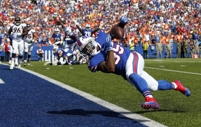 <p>Buffalo Bills fullback Mike Tolbert drops a pass from quarterback Tyrod Taylor during the first half of an NFL football game against the Denver Broncos, Sunday, Sept. 24, 2017, in Orchard Park, N.Y. (AP Photo/Jeffrey T. Barnes) </p>