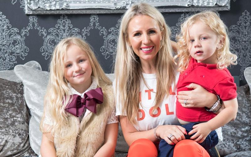 Naomi Isted with her two children: John Lewis recently ditched 'boys' and 'girls' labels from its children's clothing range. But is the unisex approach practical? Victoria Lambert reports - Paul Grover
