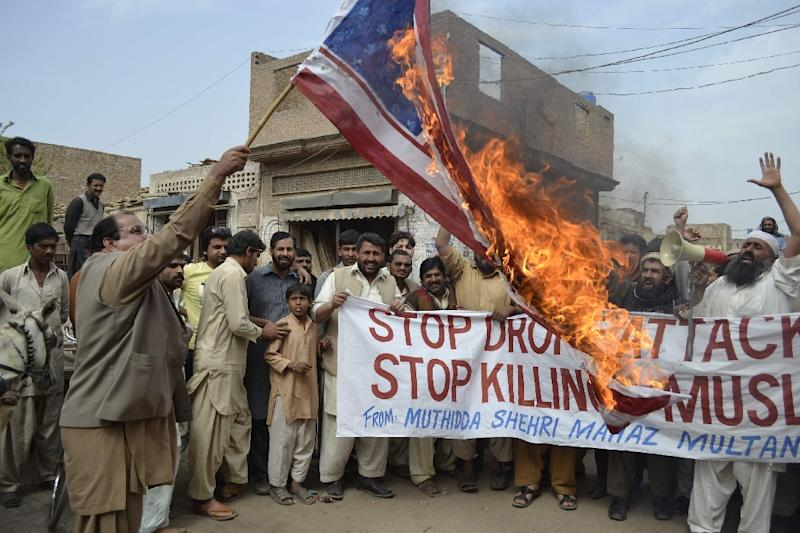 Activists of Pakistan Muthidda Shehri Mahaz burn the US flag during a protest in Multan against US drone attacks in 2012 (AFP Photo/S. S. Mirza)