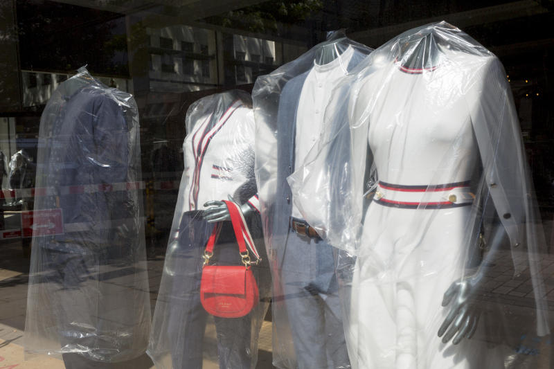 As the UK's Coronavirus death toll during the government's social distancing lockdown, rose by 384 to 33,998, and the R rate of infection is reported to be between 0.7 and 1.0, clothing mannequins in the window of a closed branch of Ted Baker, are covered in polythene plastic, in a deserted City of London, the capital's financial district, on 15th May 2020, in London, England. (Photo by Richard Baker / In Pictures via Getty Images)