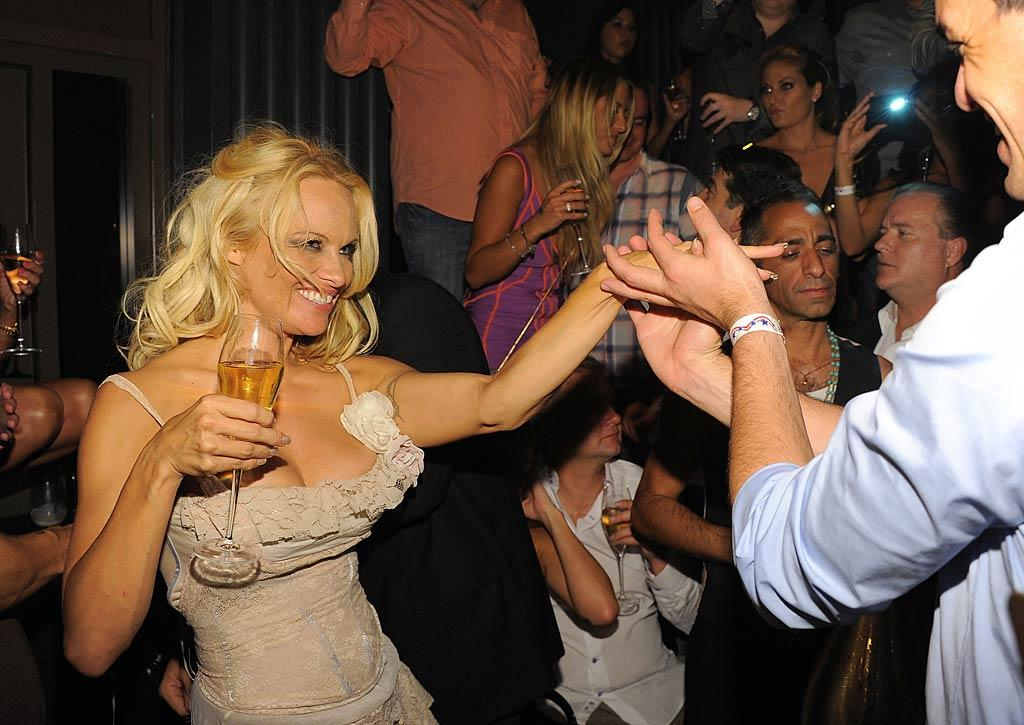 "She did, however, enjoy a dance -- and a glass of bubbly -- with one of her many party revelers. Angela Weiss/<a href=""http://www.wireimage.com"" target=""new"">WireImage.com</a> - July 30, 2011"