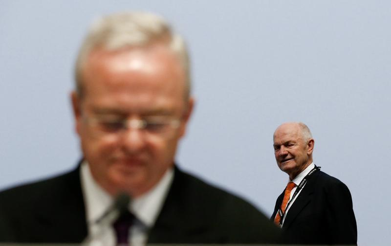 Chairman of the supervisory board of German carmaker Volkswagen Piech walks beside President and CEO of Porsche Automobil Holding SE Winterkorn as they attend the annual shareholders meeting of Porsche in Leipzig