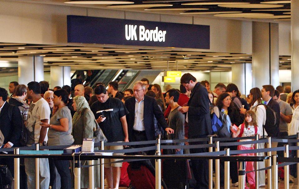 Queues at Border Control in Terminal Five of London's Heathrow Airport where some immigration and customs staff have joined a day of strikes by teachers, civil servants and other workers over Government plans to change their pensions, cut jobs and freeze pay.