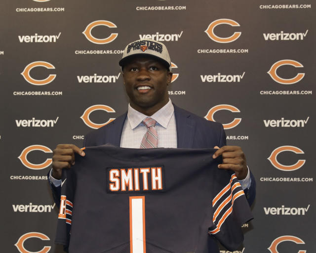 Chicago Bears first round draft pick, University of Georgia linebacker Roquan Smith, poses with a jersey during an introductory NFL football news conference Friday, April 27, 2018, in Lake Forest , Ill. (AP Photo/Charles Rex Arbogast)