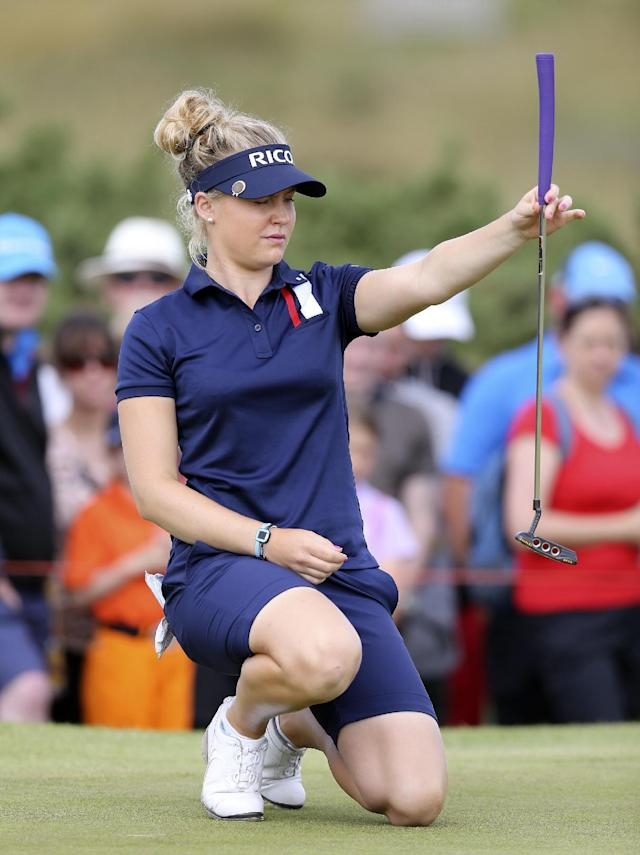 England's Charley Hull lines her putt on the 9th green during the third day of the Women's British Open golf championship on the Royal Birkdale Golf Club, Southport, England, Saturday, July 12, 2014. (AP Photo/Scott Heppell)