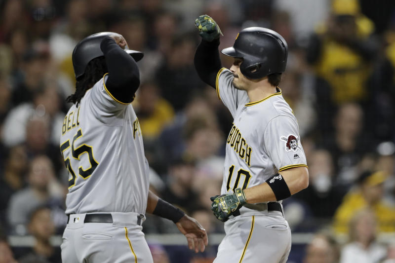 Pittsburgh Pirates' Bryan Reynolds, right, is greeted by Josh Bell after hitting a two-run home run during the fourth inning of the team's baseball game against the San Diego Padres, Friday, May 17, 2019, in San Diego. (AP Photo/Gregory Bull)