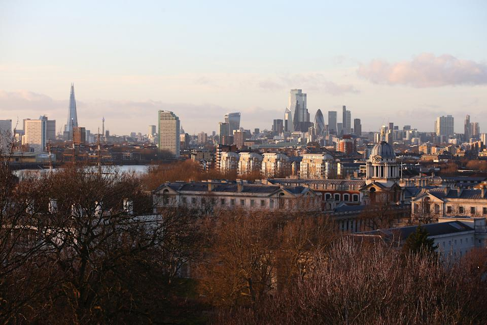 LONDON, ENGLAND - DECEMBER 27: A view of The Shard skyscraper and City of London skyline from the top of Greenwich Park on December 27, 2020 in London, United Kingdom. Last week, the British government scrapped a plan to allow household mixing in England for five days over Christmas. In London and southeast, household mixing was banned, and in other parts of the country indoor meetups were confined to Christmas Day.  (Photo by Hollie Adams/Getty Images)