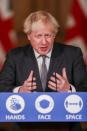 FILE PHOTO: Britain's PM Johnson holds a news conference at Downing Street in London