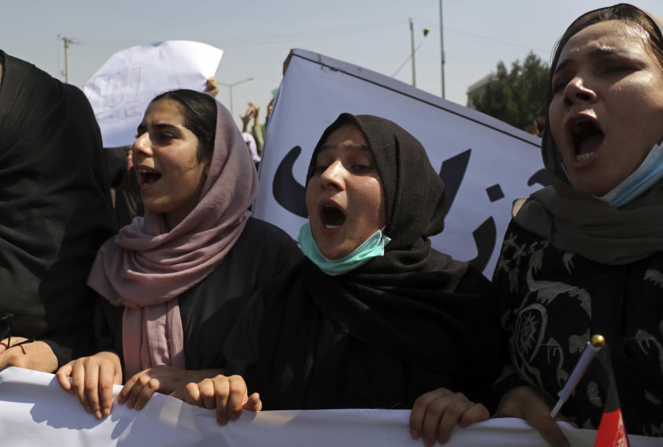 Afghan women shout slogans during an anti-Pakistan demonstration, near the Pakistan embassy in Kabul, Afghanistan, Tuesday, Sept. 7, 2021. (AP Photo/Wali Sabawoon)