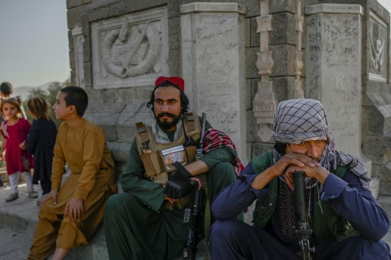 After years of fighting in the countryside, some Taliban fighters got their first visit to the Kabul Zoo (AFP/BULENT KILIC)