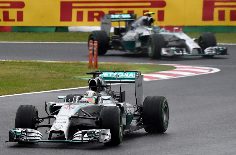 Mercedes driver Lewis Hamilton (front) increased his lead over teammate Nico Rosberg to 10 points with four races left this season, after winning the Japanese Grand Prix in Suzuka, on October 5, 2014 (AFP Photo/Toru Yamanaka)