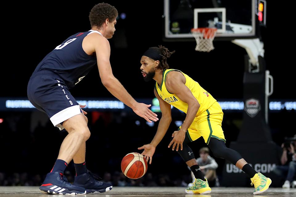 MELBOURNE, AUSTRALIA - AUGUST 24: Patty Mills of the Boomers and Brook Lopez of USA in action during game two of the International Basketball series between the Australian Boomers and United States of America at Marvel Stadium on August 24, 2019 in Melbourne, Australia. (Photo by Jonathan DiMaggio/Getty Images)
