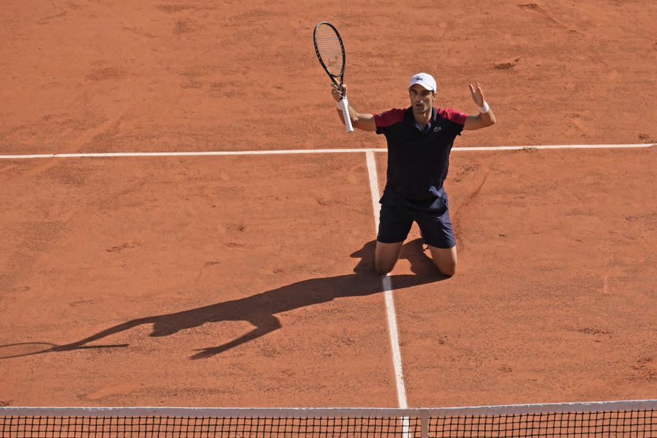 Spain's Pablo Andujar celebrates after defeating Austria's Dominic Thiem in their first round match of the French Open tennis tournament at the Roland Garros stadium Sunday, May 30, 2021 in Paris. (AP Photo/Christophe Ena)