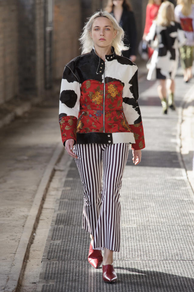 <p><i>A model wears a patchwork cow- and floral-printed moto jacket. (Photo: ImaxTree) </i></p>