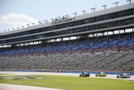 The grandstand is viewed at Texas Motor Speedway during a NASCAR Cup Series auto race in Fort Worth, Texas, Sunday, July 19, 2020. (AP Photo/Ray Carlin)