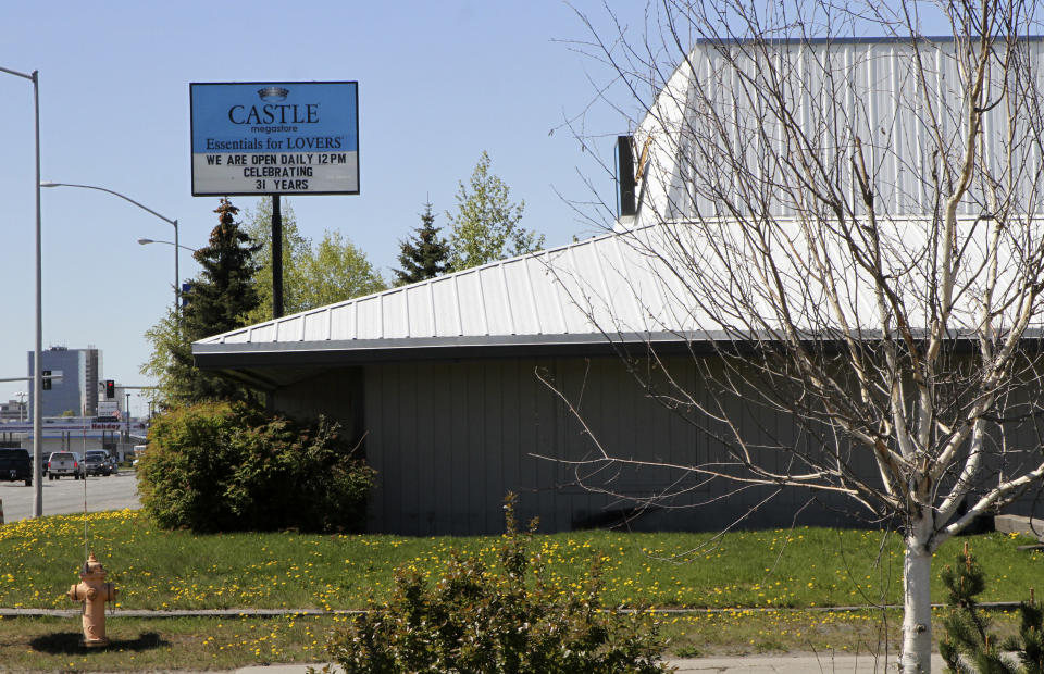 This May 24, 2021, shows a sex store across the street from the Open Door Baptist Church , located inside a former strip club in Anchorage, Alaska. Pastor Kenny Menendez hopes that the church — which is also situated between a marijuana retail store and downtrodden motels — could be a start to improving the neighborhood. (AP Photo/Mark Thiessen)