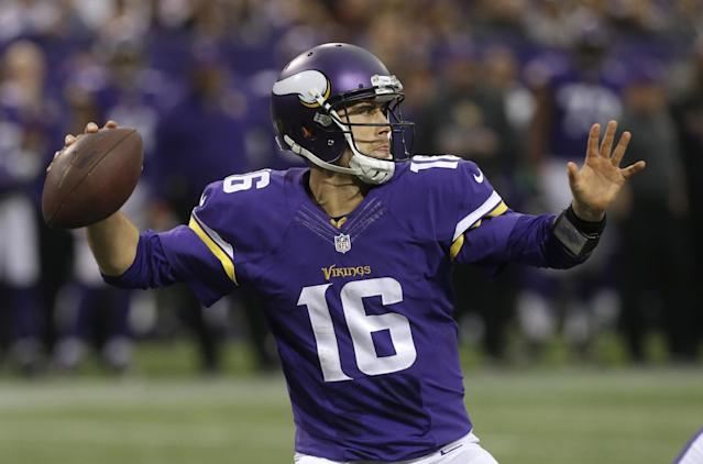 Minnesota Vikings quarterback Matt Cassel throws a pass during the second half of an NFL football game against the Detroit Lions, Sunday, Dec. 29, 2013, in Minneapolis. (AP Photo/Jim Mone)