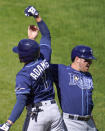 Tampa Bay Rays' Willy Adames (1) is greeted near the dugout by Hunter Renfroe after hitting a solo home run off Baltimore Orioles starting pitcher John Means during the fourth inning of a baseball game, Sunday, Sept. 20, 2020, in Baltimore. (AP Photo/Julio Cortez)