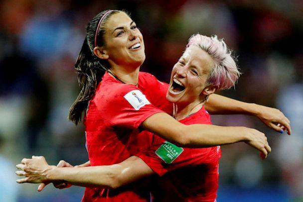 PHOTO: In this June 11, 2019 file photo, Alex Morgan of the U.S. celebrates scoring their 12th goal against Thailand in the 2019 World Cup with Megan Rapinoe. (Christian Hartmann/Reuters)