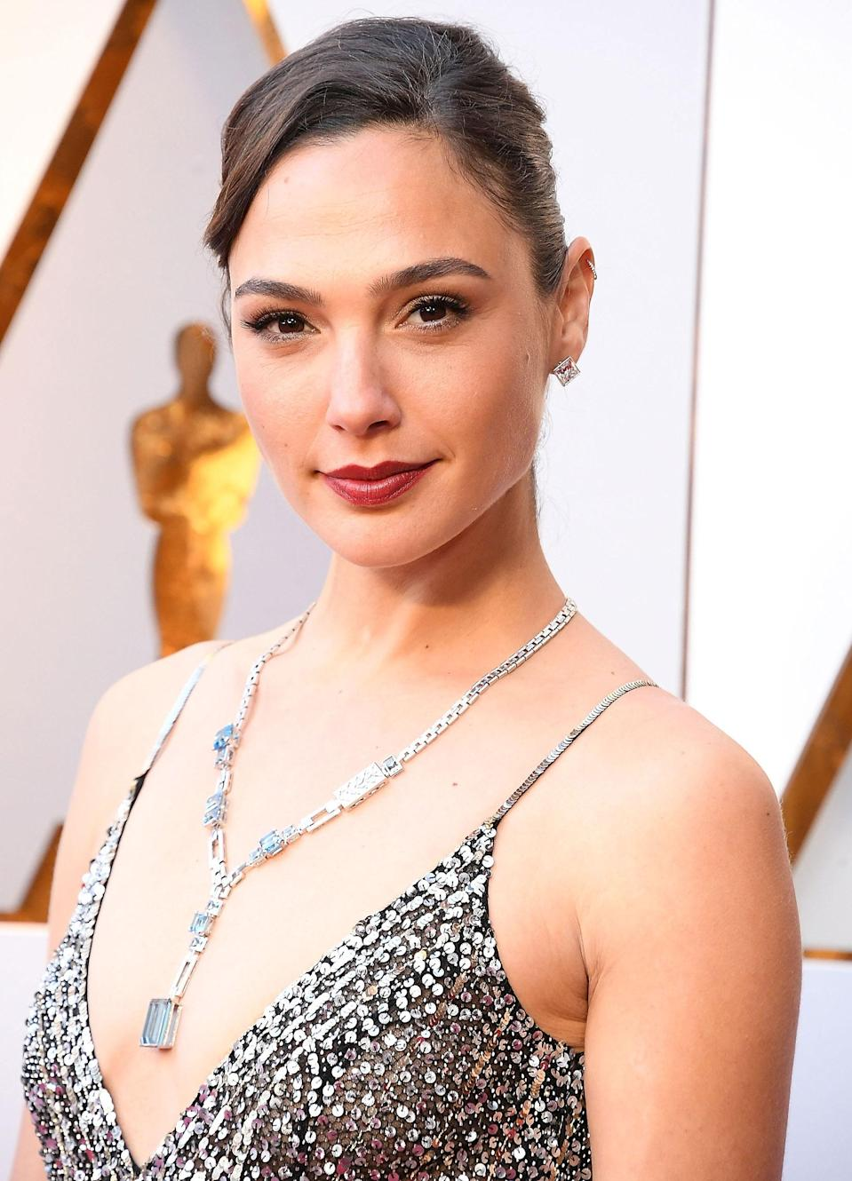 Worthy of Wonder Woman, Gal Gadot's astonishing Tiffany Blue Book collection necklace featured 61 carats worth of aquamarines and more than a thousand diamonds to boot. The Art Deco–inspired piece brought added color and vibrancy to Gadot's silver Givenchy look and proved instantly iconic.