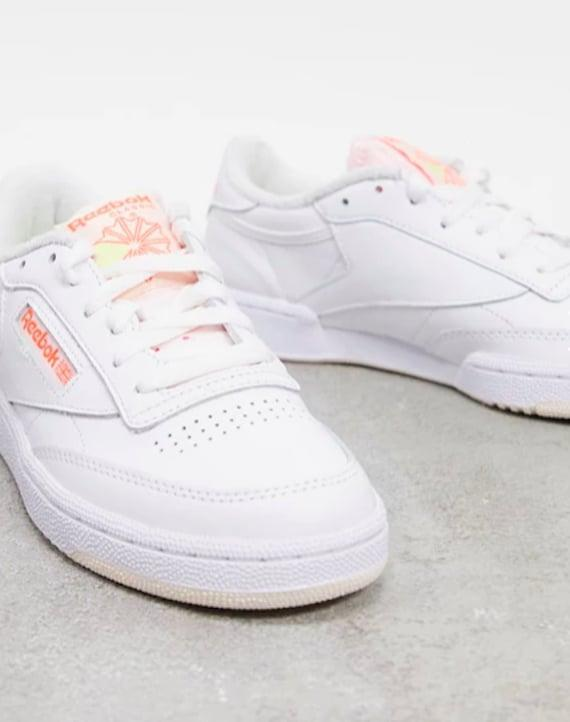 "<p><span>Reebok Club C Sneakers</span> ($70)</p> <p>""I'm really into all the throwback sneakers, but this Reebok pair is my favorite. I'll wear these all spring and summer long with denim."" - Macy Cate Williams, senior editor, Shop</p>"
