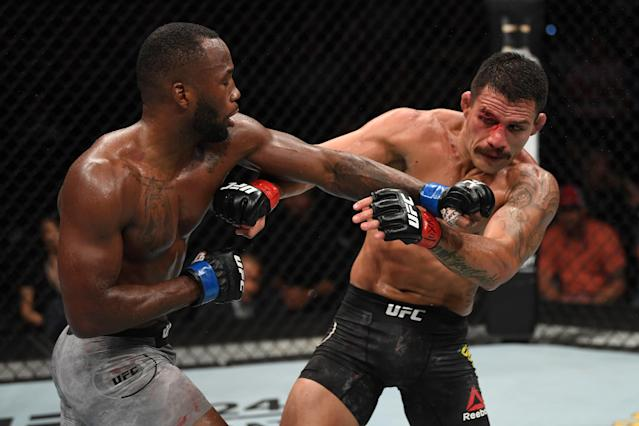 Leon Edwards of Jamaica punches Rafael Dos Anjos of Brazil in their welterweight bout during the UFC Fight Night event at AT&T Center on July 20, 2019 in San Antonio, Texas. (Getty Images)