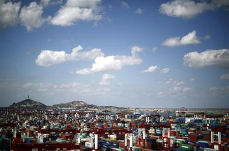 A container area is seen at the Yangshan Deep Water Port, part of the newly announced Shanghai Free Trade Zone, south of Shanghai September 26, 2013. REUTERS/Carlos Barria