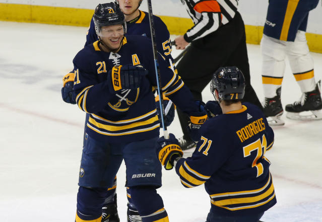 Buffalo Sabres forwards Kyle Okposo (21) and Evan Rodrigues (71) celebrate a goal during the first period of an NHL hockey game against the Nashville Predators Tuesday, April 2, 2019, in Buffalo, N.Y. (AP Photo/Jeffrey T. Barnes)