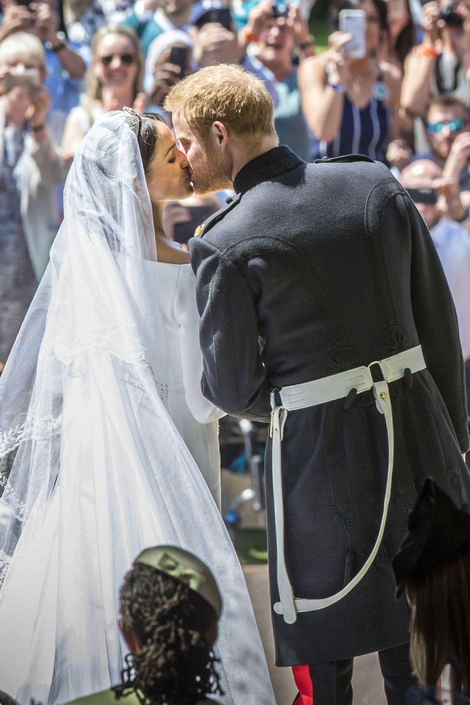 <p>Talk about a swoonworthy moment! Harry and Meghan kissed outside the steps of St. George's Chapel as crowds cheered for the newlyweds. </p>