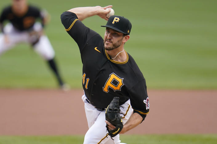 Pittsburgh Pirates starting pitcher Connor Overton delivers during the first inning of a baseball game against the Cincinnati Reds in Pittsburgh, Thursday, Sept. 16, 2021. (AP Photo/Gene J. Puskar)