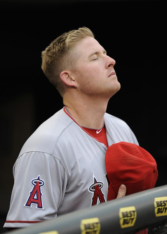 MINNEAPOLIS, MN - APRIL 15: Mark Trumbo of the Los Angeles Angels of Anaheim stands during the National Anthem following a moment of silence to honor the victims of the Boston Marathon bombing before the game against the Minnesota Twins on April 15, 2013 at Target Field in Minneapolis, Minnesota. All uniformed team members are wearing jersey number 42 in honor of Jackie Robinson Day. (Photo by Hannah Foslien/Getty Images)