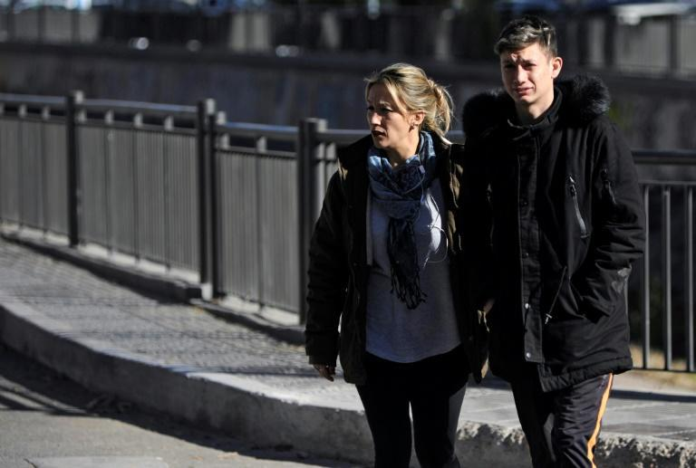 Argentinian Ezequiel Villalonga (R), 18, a victim of sexual abuse, walks with his mother Natalia along a street in Mendoza, Argentina (AFP Photo/Andres Larrovere)
