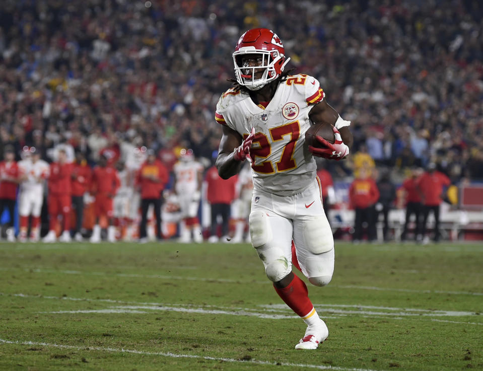 FILE - In this Nov. 19, 2018, file photo, Kansas City Chiefs running back Kareem Hunt carries during the second half of the team's NFL football game against the Los Angeles Rams in Los Angeles. A person with knowledge of the move tells The Associated Press that Hunt appears headed to the NFL's Commissioner Exempt List, sidelining him while the league investigates a video of Hunt striking a woman in February. The person spoke on condition of anonymity because the team had not issued a formal statement Friday, although one was expected for later in the evening. (AP Photo/Kelvin Kuo, File)