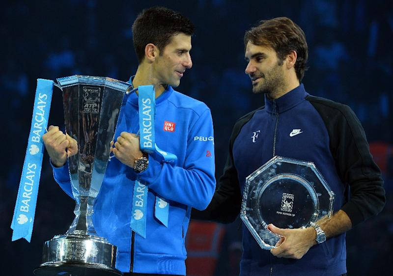 Serbia's Novak Djokovic (L) and Switzerland's Roger Federer, pictured on November 22, 2015, are both on the brink of becoming the first men in tennis to hit $100 million in on-court earnings