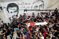 Palestinians carry the body of Obaidah Jawabreh, killed a day earlier during clashes with Israeli soldiers, at his funeral