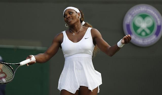 Serena Williams of U.S. gestures during the women's singles match against Alize Cornet of France at the All England Lawn Tennis Championships in Wimbledon, London, Saturday, June 28, 2014. (AP Photo/Sang Tan)