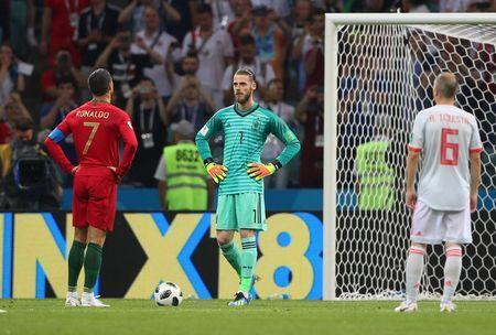 Soccer Football - World Cup - Group B - Portugal vs Spain - Fisht Stadium, Sochi, Russia - June 15, 2018 Portugal's Cristiano Ronaldo prepares to take a penalty as Spain's David De Gea looks on REUTERS/Hannah McKay