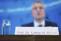The head of the Robert Koch Institute, Germany's federal government agency and research institute responsible for disease control and prevention, Lothar Wieler, addresses a news conference on the coronavirus and the COVID-19 disease in Berlin, Thursday, Oct. 22, 2020. Germany's disease control center is reporting a new daily record increase in coronavirus infections, which rocketed past the 10,000 mark for the first time as the pandemic continues to spread. (AP Photo/Markus Schreiber, Pool)