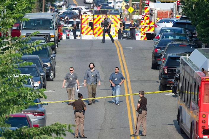 <p>Police and emergency personnel are seen near the scene where House Majority Whip Steve Scalise of La. was shot during a Congressional baseball practice in Alexandria, Va., Wednesday, June 14, 2017. (Photo: Cliff Owen/AP) </p>