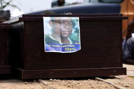 Engr. Mvihi Shanondo's picture is seen among the coffins of people killed by the Fulani herdsmen, in Makurdi, Nigeria January 11, 2018. REUTERS/Afolabi Sotunde