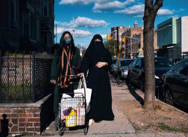 PHOTO: Sisters Shahana Hanif (left) and Sabia Hanif, community organizers in Kensington, Brooklyn, in New York City, perform a delivery during the coronavirus pandemic, May 2020. (Anna Rathkopf)