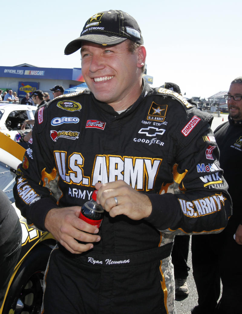 FILE - In this Oct. 22, 2011, file photo, NASCAR Sprint Cup Series driver Ryan Newman smiles after qualifying for the Good Sam Club 500 auto race at the Talladega Superspeedway in Talladega, Ala. The U.S. Army will not return to Stewart-Haas Racing next season, citing a reallocation of its marketing budget that does not include a presence in NASCAR.  SHR said Tuesday, July 10, 2012, it is pursuing a new sponsor. (AP Photo/Terry Renna, File)