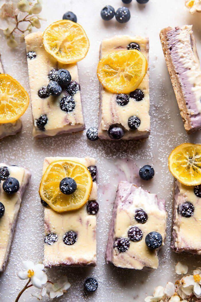 "<a href=""https://www.halfbakedharvest.com/blueberry-lemon-cheesecake-bars-with-candied-lemon/"" rel=""nofollow noopener"" target=""_blank"" data-ylk=""slk:Get the Blueberry Lemon Cheesecake Bars recipe from Half Baked Harvest"" class=""link rapid-noclick-resp""><strong>Get the Blueberry Lemon Cheesecake Bars recipe from Half Baked Harvest</strong></a>"