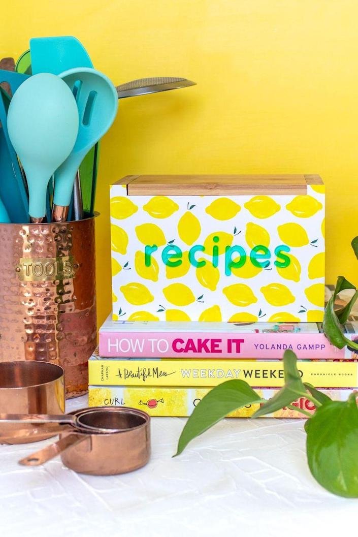 """<p>Peel-and-stick wallpaper makes it easy to customize a simple recipe box for your mom. Pro tip: Pick a design that'll work well with her current kitchen décor.</p><p><strong>Get the tutorial at <a href=""""https://www.clubcrafted.com/recipe-box-makeover-wallpaper/"""" rel=""""nofollow noopener"""" target=""""_blank"""" data-ylk=""""slk:Club Crafted"""" class=""""link rapid-noclick-resp"""">Club Crafted</a>.</strong></p><p><strong><a class=""""link rapid-noclick-resp"""" href=""""https://go.redirectingat.com?id=74968X1596630&url=https%3A%2F%2Fwww.walmart.com%2Fip%2FThe-Pioneer-Woman-Peel-and-Stick-Wallpaper-Fiona-Floral-18-X-18-86%2F739692015&sref=https%3A%2F%2Fwww.thepioneerwoman.com%2Fholidays-celebrations%2Fgifts%2Fg32307619%2Fdiy-gifts-for-mom%2F"""" rel=""""nofollow noopener"""" target=""""_blank"""" data-ylk=""""slk:SHOP WALLPAPER"""">SHOP WALLPAPER</a><br></strong></p>"""