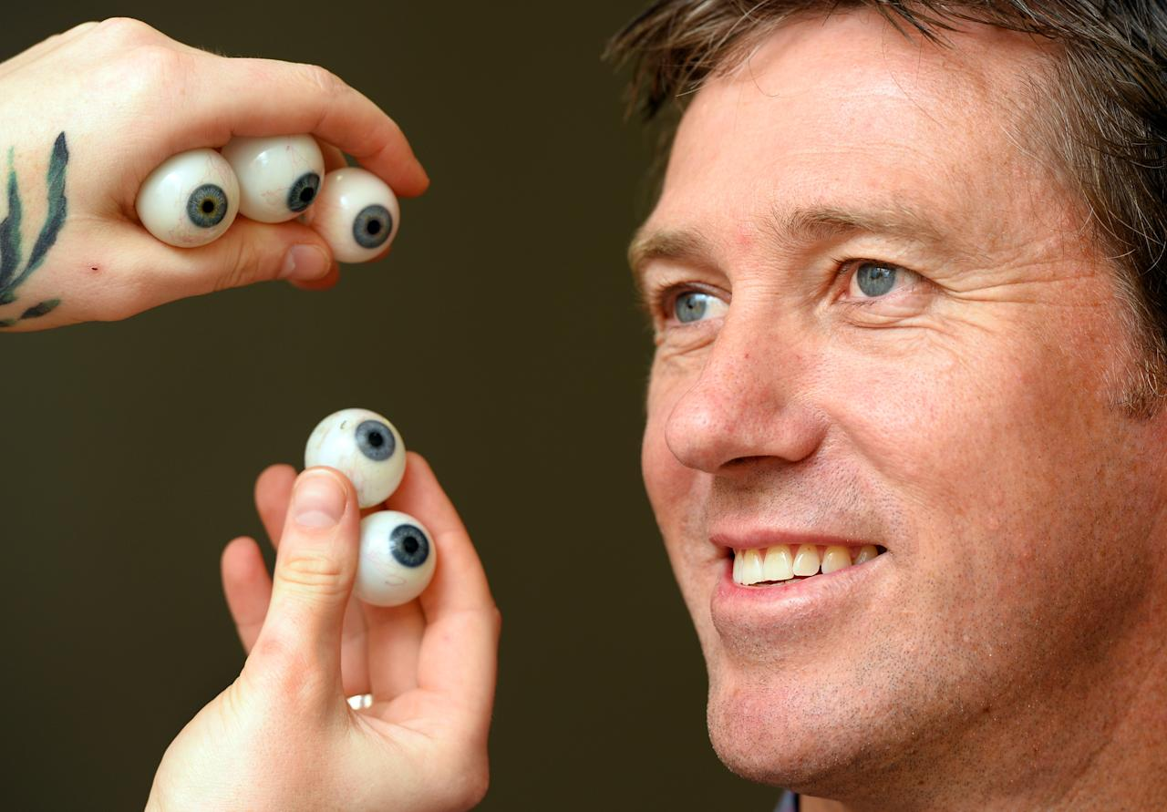 Former Australian cricket star Glenn McGrath sits still as a team from Madame Tussauds takes over 250 measurements along with exact colour matches of his eyes, skin tone and hair to make the final figure, in Sydney on February 13, 2013.  The team will now fly back to the Madame Tussauds headquarters in London where they will take a further 800 hours to create and perfect McGrath?s figure before going on display along side fellow cricketing legend Shane Warne aT Madame Tussauds in Sydney.  AFP PHOTO/William WEST        (Photo credit should read WILLIAM WEST/AFP/Getty Images)