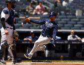 Tampa Bay Rays' Kevin Kiermaier scores a run past New York Yankees catcher Kyle Higashioka during the third inning of a baseball game on Monday, May 31, 2021, in New York. The Rays won 3-1. (AP Photo/Adam Hunger)