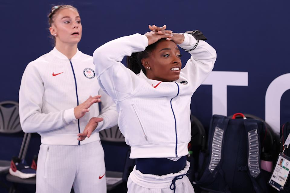 TOKYO, JAPAN - JULY 27: Simone Biles of Team United States reacts during the Women's Team Final on day four of the Tokyo 2020 Olympic Games at Ariake Gymnastics Centre on July 27, 2021 in Tokyo, Japan. (Photo by Laurence Griffiths/Getty Images)